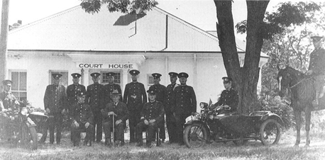 Police posing outside Acton House